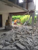 afbraakwerken  en uitbreken vloerpakket